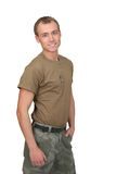 Army soldier guy. One fit attractive soldier in a brown t-shirt with dogtags half length portrait over white royalty free stock photos