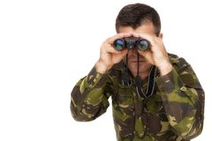 Army soldier looking through binoculars Stock Photography