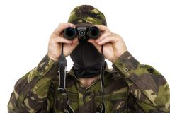 Army soldier looking through binoculars Stock Photos