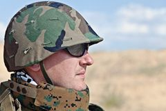 Army soldier. Soldier in the military helmet half-turned to the camera stock image