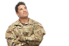 Army soldier smiling and looking up Royalty Free Stock Photo