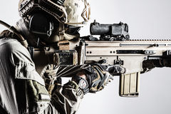 Army soldier of Special Operations Forces. Army soldier in Protective Combat Uniform holding Special Operations Forces Combat Assault Rifle. Shooting weapon stock photos