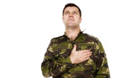 Army soldier swear solemnly with hand on heart. Isolated on white background Stock Photos