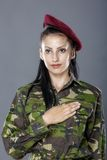 Army soldier swear solemnly with hand. On heart to defend country Royalty Free Stock Photography