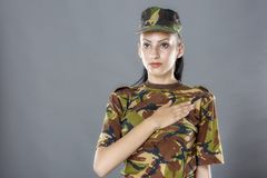 Army soldier swear solemnly with hand. On heart to defend country Royalty Free Stock Photo
