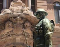 Army soldier at the Sydney Cenotaph. Is located in Martin Place with the post office in the background - Anzac Day - war memorial Royalty Free Stock Photography