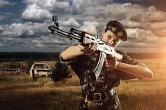 Army soldier woman is on the battle field Royalty Free Stock Photos