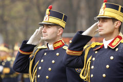Army soldiers saluting Stock Photography