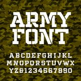 Army stencil alphabet font. Type letters and numbers on a green camo seamless background. stock illustration