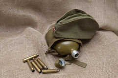 Army still life on the background fabric. Stock Image