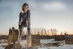Army style portrait of cute lady on winter background Stock Photo