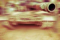 Army tank motion blur. Close up on gun barrel Stock Photo