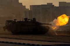 Free Army Tanks Shooting And Driving In The Desert Town In War And Military Conflict. Military Concept Of War And Explosions Royalty Free Stock Image - 163946386