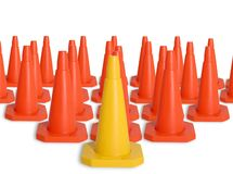 Army of traffic cones. The first one is yellow, the rest orange Stock Image