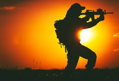 Army Trooper with Rifle. Army Trooper with Assault Rifle in Mission. Military Mission at Sunset. Military Concept Royalty Free Stock Photography