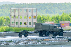 Army truck transports gun after water ford Stock Image