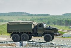 Army truck URAL-4320 jumps through obstacle Stock Photo