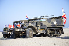 Army trucks of organization Kelly's Heroes riding on beach Stock Photo