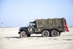 Army trucks of organization Kelly's Heroes riding on beach Stock Images