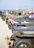Army trucks of organization Kelly's Heroes riding on beach Stock Photography