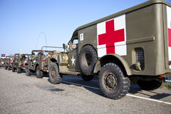 Army trucks of organization Kelly's Heroes riding on beach Stock Photos