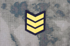 Army uniform with sergeant rank patch. Background royalty free stock photos