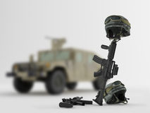 Army vehicle. Weapons and helmets on the background of an army vehicle Royalty Free Stock Image