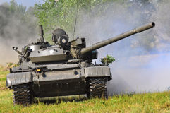 Army vehicle in the fight. World war, army vehicle in action, tank when shooting at war Royalty Free Stock Photography