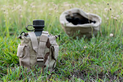 Army water canteen with desert cover Stock Photo