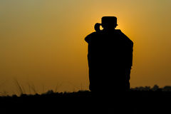 Army water canteen. Silhouette shot of Army water canteen on sunset background Stock Photo