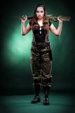 Army Woman With Gun - Beautiful woman with rifle plastic Stock Photo