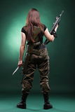 Army Woman With Gun - Beautiful woman with rifle plastic. Beautiful woman with rifle plastic Military Army girl Holding Gun green background Stock Images