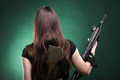 Army Woman With Gun - woman with rifle plastic. Beautiful woman with rifle plastic Military Army girl Holding Gun green background Stock Photos
