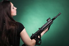 Army Woman With Gun - woman with rifle plastic Stock Photo