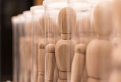 Army of wooden mannequins in boxes Stock Images