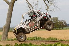 Front end landing. ARNCOTT, UK - MAY 4: An unnamed driver competing in the UK SXS RZR series lands on the top of the table-top jump before heading into a left Royalty Free Stock Photography