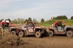 Racing car pile up. ARNCOTT, UK - MAY 4: Unnamed drivers competing in the UK SXS RZR series reach the first tight corner after the start line resulting in some Royalty Free Stock Image