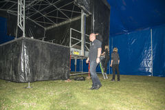 Arne Mørk inspect the progress of the tent. Konsert Teknikk AS which is supplier of stage, sound, lighting and vision for medium and large events has overall Royalty Free Stock Photography