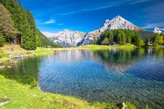 Arnisee lake with Swiss Alps. Arnisee is a reservoir in the Canton of Uri, Switzerland. Arnisee lake in Swiss Alps. Arnisee is a reservoir in the Canton of Uri royalty free stock images