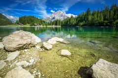 Arnisee with Swiss Alps. Arnisee is a reservoir in the Canton of Uri, Switzerland, Europe.  stock photo