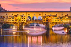 Arno and Ponte Vecchio at sunset, Florence, Italy Royalty Free Stock Photos