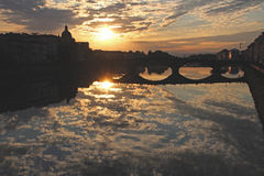 Arno reflections. Image of reflections of a sunset on the Arno in Florence Stock Photo
