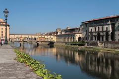 Arno river banks and Ponte Vecchio Stock Photo