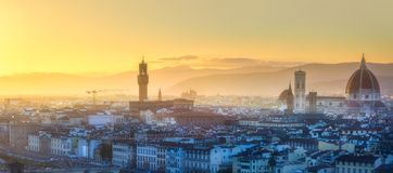 Arno River and Basilica at sunset Florence, Italy. Panoramic view of Arno River, Ponte Vecchio and Palace, Basilica of Santa Croce, Boboli and Bardini gardens at royalty free stock images