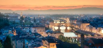 Arno River and Basilica at sunset Florence, Italy. Panoramic view of Arno River, Ponte Vecchio and Palace, Basilica of Santa Croce, Boboli and Bardini gardens at stock photography