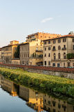 Arno River and Bridges Florence. Florence, Italy-June 12, 2015.Historic buildings reflecting the Arno River, Florence, Italy, in warm late afternoon sunlight Royalty Free Stock Photo