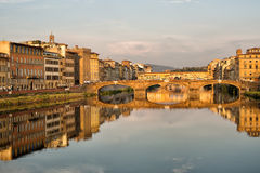 Arno River and Bridges Florence. Florence, Italy-June 12, 20015.View of the Arno River and the buildings along it`s banks, looking towards the Ponte Santa Royalty Free Stock Images