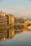 Arno River and Bridges Florence. Florence, Italy-June 12, 20015.View of the Arno River and the buildings along it`s banks, looking towards the Ponte Santa Stock Images