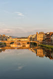 Arno River and Bridges Florence. Florence, Italy-June 12, 20015.View of the Arno River and the buildings along it`s banks, looking towards the Ponte Santa Royalty Free Stock Image