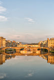 Arno River and Bridges Florence. Florence, Italy-June 12, 20015.View of the Arno River and the buildings along it`s banks, looking towards the Ponte Santa Stock Photos